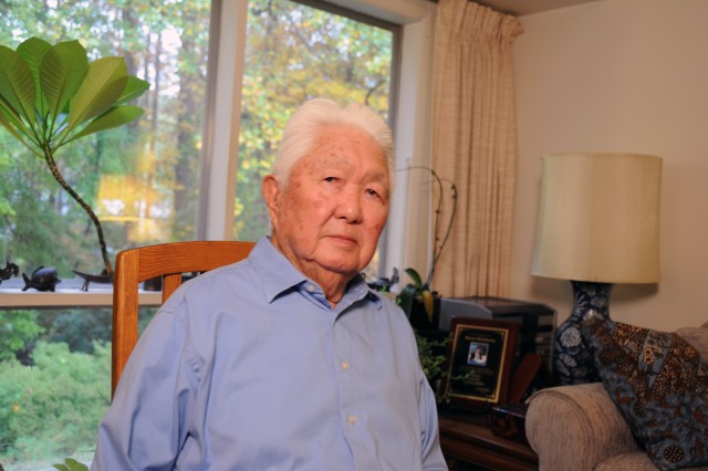 Grant Ichikawa, a former military intelligence officer with the Army and CIA, sits in his living room in Vienna, Va.  He and other Japanese-American veterans will receive Congressional Gold Medals this week for their contributions during World War II.
