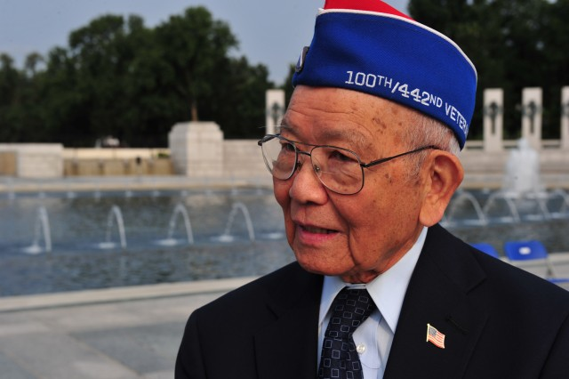 Terry Shima, a veteran of the 442nd Regimental Combat Team, stands beside the World War II memorial on V-J Day 2011. He and other Japanese-American veterans will receive Congressional Gold Medals this week.
