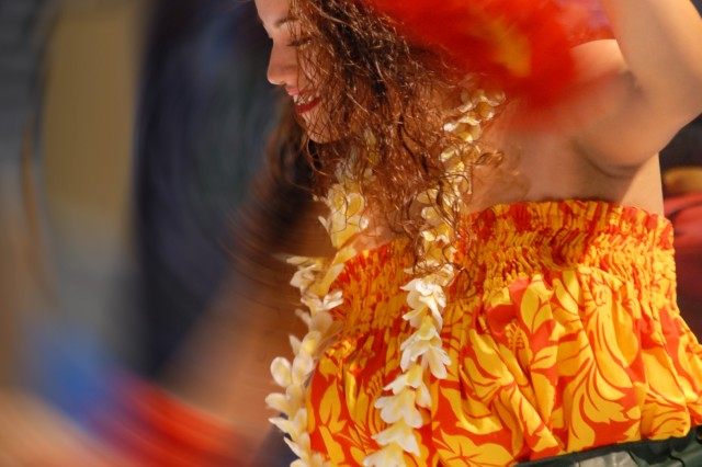 Shamonique Muai, a performer for the Hawaii division of the United States Army Pacific, performs a traditional Hawaiian dance for spectators during the 57th Association of the United States Army (AUSA) 2011 Annual Meeting & Exposition at the Walter E. Washington Convention Center in Washington D.C. Oct. 10-12.
