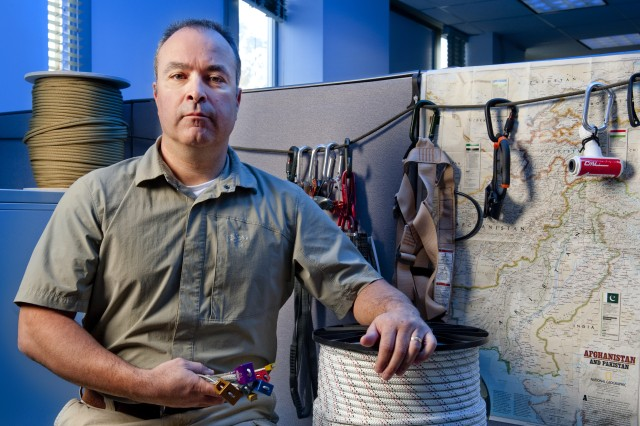 Darren Bean, project manager for mountaineering, Product Manager Soldier Clothing and Individual Equipment, displays some of the tools of the trade at Natick Soldier Systems Center.