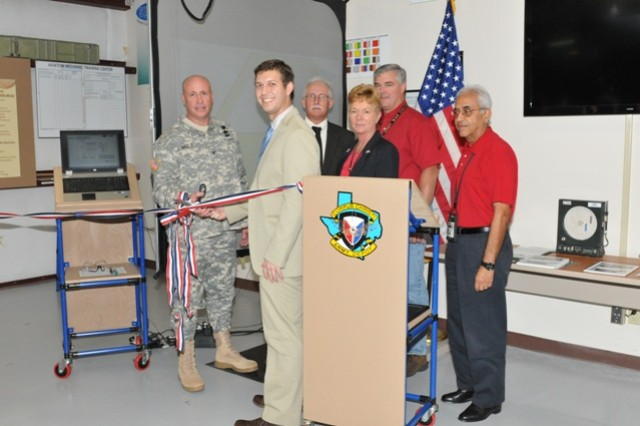 Col. Christopher Carlile, Graig Jolley, Rick Klein, Annette Cross, Kresten Cook and Moheb Assad cut the ribbon to the STAR4D Painter Training and Certification Program and the use of the CCAD Aviation Training Center. Photo by Kiana Allen.
