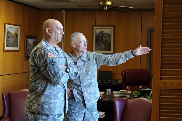 U.S. Army Maj. Gen. James L. Terry, Commanding General of the 10th Mountain Division, shows the view from his office to Gen. Raymond T. Odierno, Chief of Staff of the Army, during his visit to Fort Drum, N.Y. Oct. 25, 2011.