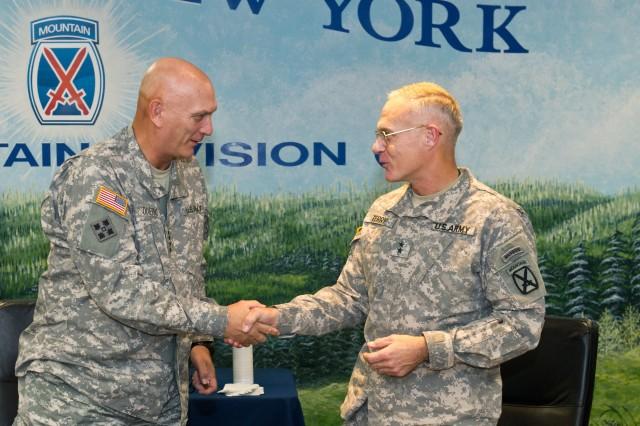 U.S. Army Gen. Raymond T. Odierno, Chief of Staff of the Army, exchange coins with Maj. Gen. James L. Terry, Commanding General of the 10th Mountain Division, during his visit to Fort Drum, N.Y. Oct. 25, 2011.