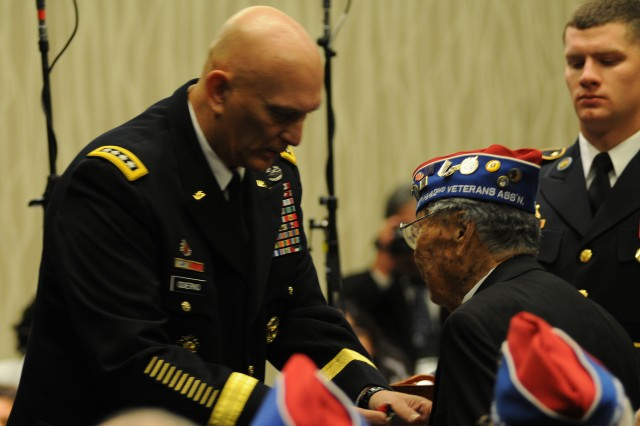Chief of Staff of the Army Gen. Raymond T. Odierno pins a Bronze Star on George Joe Sakato, Medal of Honor recipient, Nov. 1, 2011, at a ceremony in Washington, D.C.  At the ceremony, 40 World War II Soldiers from the all- Japanese-American units -- the 442nd Regimental Combat Team, the 100th Infantry Battalion and the Military Intelligence Service -- were awarded the Bronze Star.