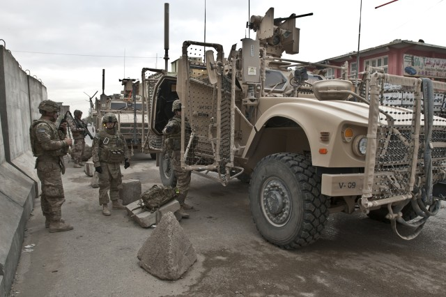 Soldiers from the 156th Military Police Detachment, attached to the 1st Air Cavalry Brigade, 1st Cavalry Division, exit their mine-resistant, ambush-protected, all-terrain vehicle outside the Balkh provincial prison in Afghanistan, Oct 23, 2011. Soldiers of the 156th MP were at the prison in order to fulfill one of their many mission sets, by enrolling the local Afghan national prisoners into a biometric system, enabling Coalition and Afghan forces to create a viable database in order to forensically identify criminals.