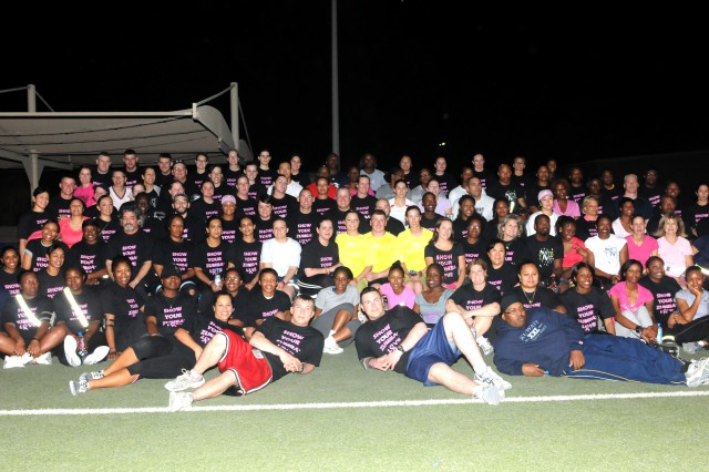 CAMP ARIFJAN, Kuwait - More than 200 Servicemembers and civilians joined together for a group photograph and participated in a Zumba Fitness event to support the Party in Pink Movement which raises awareness of breast cancer here Oct. 28. October is Breast Cancer Awareness Month, which is an annual campaign to increase awareness of the disease by educating the public about early detection, the cause, diagnosis, treatment, and support for survivors. Third Army's hosting of the Zumba Fitness event for breast cancer awareness provides Soldiers education on the disease and reinforces the value of healthy living for being ready tonight and prepared for tomorrow.