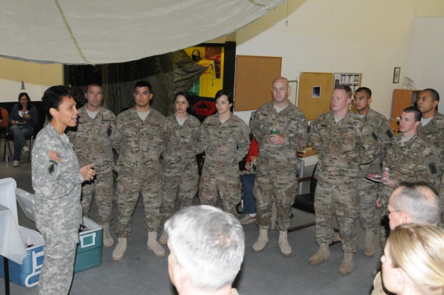 Brig. Gen. Nadja West, commander of Europe Regional Medical Command, speaks to the Soldiers of the 67th Forward Surgical Team (Airborne) following the unit's casing ceremony in Miesau, Germany October 28.