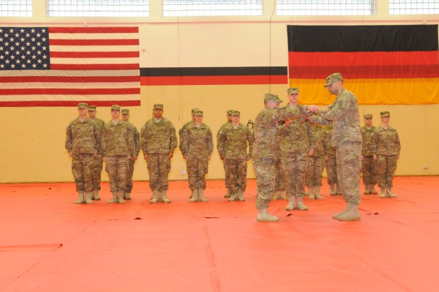 The leadership of the 67th Forward Surgical Team (Airborne) case the units guidon during a ceremony in Miesau, Germany October 28.