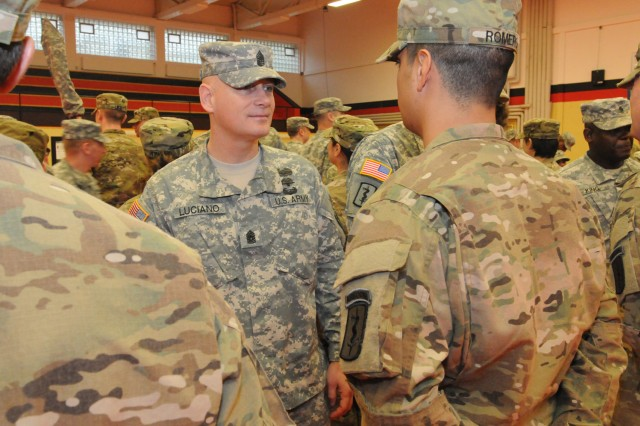 Command Sgt. Major Robert Luciano, the Europe Regional Medical Command command sergeant major, speaks to Sgt. Antonio Romero of the 67th Forward Surgical Team (Airborne) following the unit's casing ceremony in Miesau, Germany October 28.
