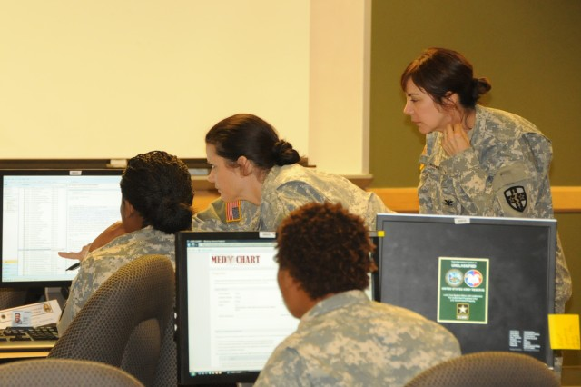 U.S. Army Reserve medical professionals discuss on the web-based programs they are learning to use during a Medical Programs conference held at the 81st Regional Support Command at Fort Jackson, S.C. October 24-28, 2011. The conference was held in order to train medical personnel on the systems and processes available to help Soldiers maintain their medical readiness. The conference attendees are expected to return to home units and train rhier subordinates in the same processes. U.S. Army photo by Sgt. 1st Class Joel Quebec, 81st RSC Public Affairs Office.