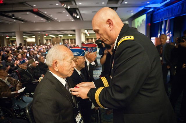 U.S. Army Chief of Staff Gen. Raymond T. Odierno presents Bronze Star Medals  and the Army Chief of Staff coins to Japanese-American World War II veterans at the World War II Nisei Veterans Program National Veterans Network tribute to the 100th Infantry Battalion, 442nd Regimental Combat Team and Military Intelligence Service Nov. 1, 2011, in Washington, D.C.