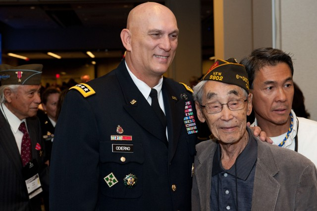 U.S. Army Chief of Staff Gen. Raymond T. Odierno stands next to a Nisei Veteran at the World War II Nisei Veterans Program National Veterans Network tribute to the 100th Infantry Battalion, 442nd Regimental Combat Team and Military Intelligence Service Nov. 1, 2011, in Washington, D.C.