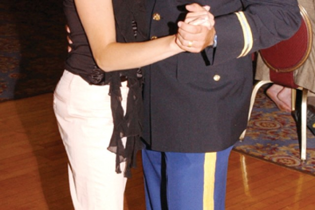 Capt. Doug and Nicole DiCenzo dance at the 2004 wedding of Jake Miller, Doug's best friend.  The DiCenzos met at a Christmas party in 1999.