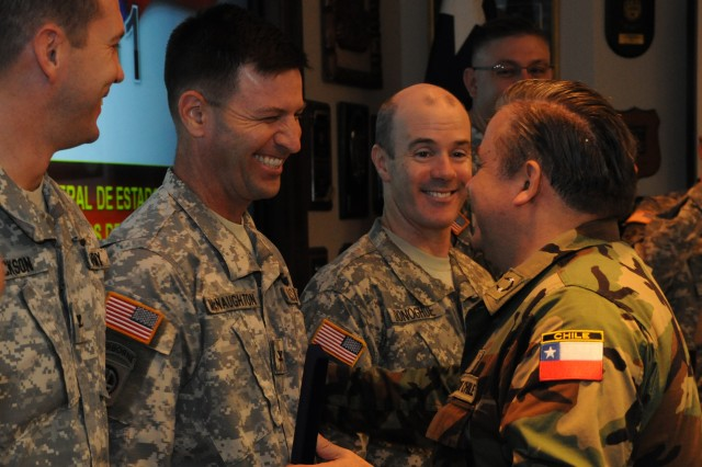 (Left to right) Col. Jerry Jackson, Army South deputy chief of staff, intelligence, Col. Brian McNaughton, Army South deputy commander, operations, and Col. John Donoghue, Army South deputy chief of staff, operations, share a laugh with Chilean Maj. Gen. Alejandro Arancibia Ramirez, director of international relations and head of the Chilean delegation, at the end of the annual army-to-army bilateral staff talks Nov. 2, 2011, at Army South headquarters at Fort Sam Houston, Texas.
