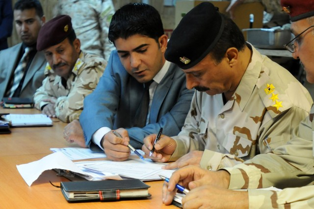 Col. Sa'di Aftan al Dulaimi, deputy logistics officer for the Anbar Operations Command, signs the necessary documents returning the Anbar Operations Command to the government of Iraq from B Company, 1st Battalion, 325th Airborne Infantry Regiment, 2nd Brigade, 82nd Airborne Division, Oct. 30, 2011. The AOC has been a hub for U.S. Forces' mission to advise, train, assist and equip Iraqi Security Forces in Anbar province since 2006.