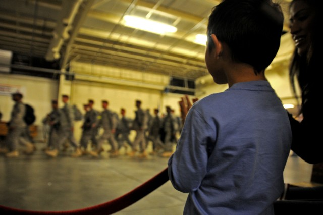 Drake Schlosser, 4, locates his dad, Staff Sgt. Dennis Schlosser, in the crowd of redeploying Soldiers returning from a 12-month deployment with XVIII Airborne Corps to Iraq, at Fort Bragg, N.C., Nov. 4, 2011.