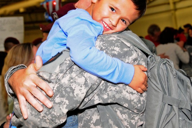 Drake Schlosser, 4, is finally reunited with his dad, Staff Sgt. Dennis Schlosser, during a welcome home ceremony after his return from a 12-month deployment with XVIII Airborne Corps to Iraq, at Fort Bragg, N.C., Nov. 4, 2011.