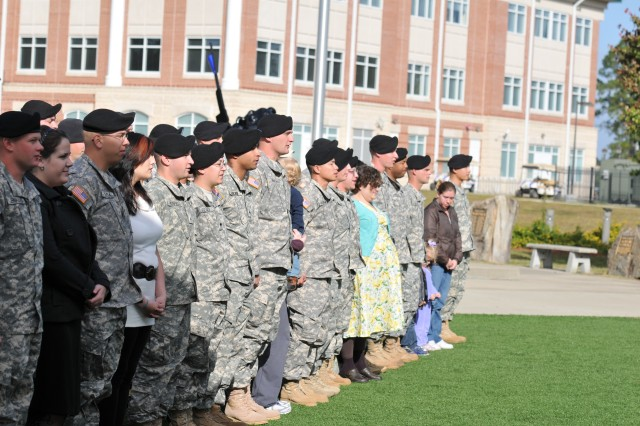 """Third Infantry Division Soldiers and their families sing the 'Dog Face Soldier' song after being re-enlisted by Maj. Gen. Robert """"Abe"""" Abrams, Third ID commanding general, Nov. 3, 2011, at Fort Stewart, Ga."""
