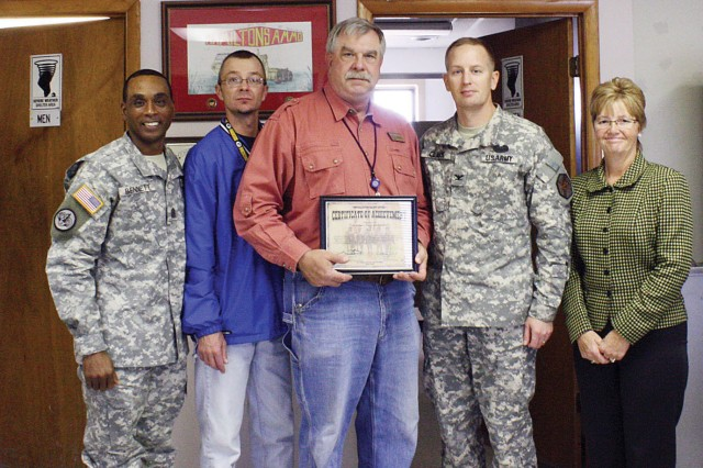 From left to right, Fort Riley Garrison Command Sgt. Maj. Colvin Bennett Sr., Scott Cook, ASP manager; Richard Eyestone, ASP accountable officer; Fort Riley Garrison Commander Col. William Clark and Fort Riley Deputy Garrison Commander Linda Hoeffner pose for a photo Nov. 1. ASP employees were presented a certificate of achievement for 1,987 accident-free days.