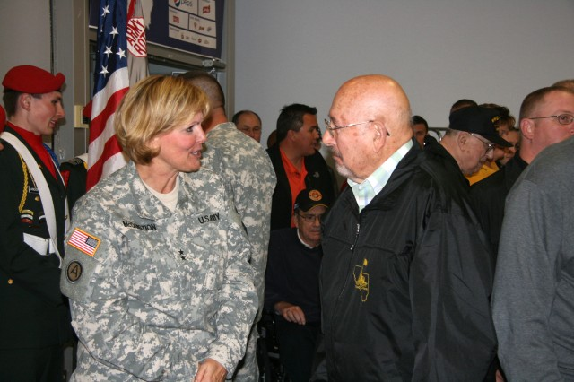 Maj. Gen. Patricia McQuistion, Army Sustainment Command commanding general, talks with a participant in the Nov. 3 Honor Flight at Northgate Place, Davenport, Iowa, where the veterans and guest gathered the night before their departure. (Photo by Jackie Hoggins, ASC Public Affairs)