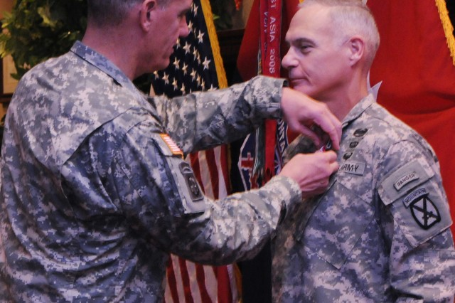 Gen. David M. Rodriguez, U.S. Army Forces commanding general, awards Maj. Gen. James L. Terry, outgoing commanding general for 10th Mountain Division (LI) and Fort Drum senior commander, the Distinguished Service Medal today at Fort Drum.