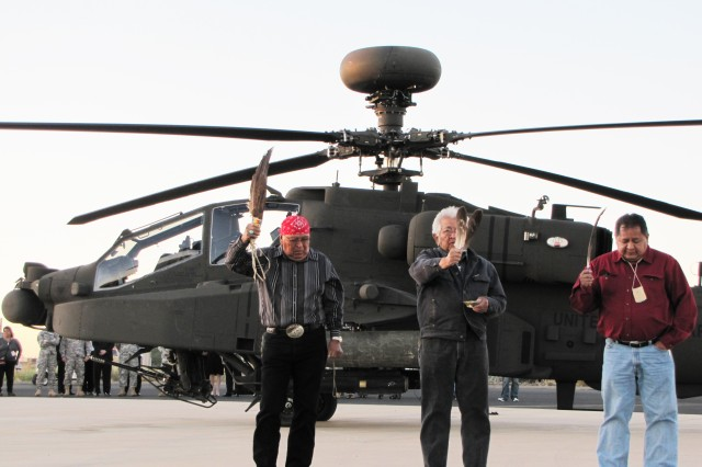White Mountain Apache  tribal elders bless the new Apache Block III aircraft at dawn Nov. 2 at the Boeing Facility in Mesa, Ariz.  The prayers and 'smudging' of the aircraft were led by tribal Chairman Ronnie Lupe, his executive officer Jerry Gloshay Jr. and spiritual leader Ramon Riley.
