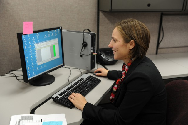 Vanessa Vinson, a Warrior Transition Brigade intern with the IRS in Austin, Texas, prepares to fill out a spreadsheet as part of her internship with the Accounts Management Taxpayer Assurance Program. The IRS piloted the Operation Warfighter internship program with Fort Hood in 2009 and has had several WTB interns since then.