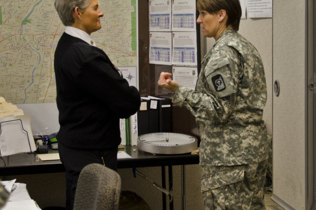 """JOINT BASE LEWIS-McCHORD, Wash. """" Col. Theresa Schneider, the 62nd Medical Brigade commander and chief nurse, talks with Rita Hutchenson, the Rainier city fire chief, at the Mission Command Training Center here Nov 1 to figure out how to bring their organizations together to successfully complete the JTF-CS mission. (Army photo by Sgt. James Hale)"""