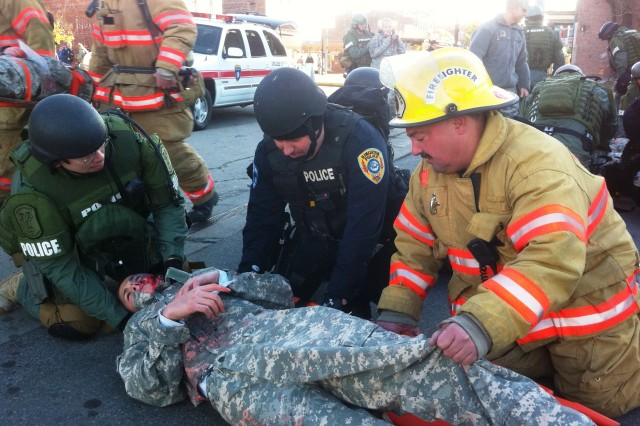 "KINGSTON, NY-- Members of the City of Kingston Fire Department and Police Department treat a ""victim"" during the dirty bomb drill local authorities staged with the New York National Guard on Nov. 5, 2011."