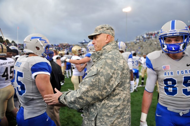 U.S. Army Chief of Staff Gen. Raymond T. Odierno congratulates Air Force Falcons players after the win over the Army Black Knights at the U.S. Air Force Academy in Colorado Springs, CO, Nov. 5, 2011.