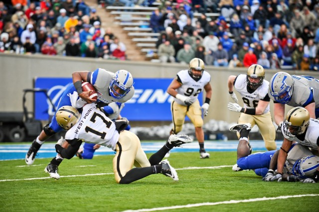 Tyler Dickson, an Army Black Knights defensive back from Mansfield, OH, tackles an Air Force player during the Army vs Air Force game at the U.S. Air Force Academy in Colorado Springs, CO, Nov. 5, 2011.