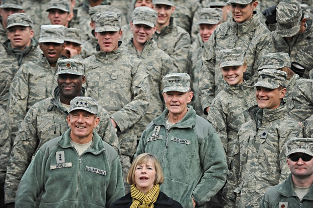 Chairman of the Joint Chiefs of Staff Army Gen. Martin E. Dempsey and his wife Deanie are accompanied by Lt. Gen. Michael C. Gould, Superintendent U.S. Air Force Academy, and a crowd of Air Force Cadets during Air Force Falcons versus Army Black Knights game at the U.S. Air Force Academy in Colorado Springs, CO, Nov. 5, 2011.