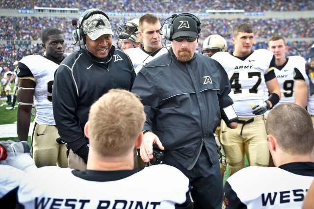 Payam Saadat, a defensive coordinator and linebackers for the Army Black Knights, talks to his players during the Army vs Air Force game at the U.S. Air Force Academy in Colorado Springs, CO, Nov. 5, 2011.