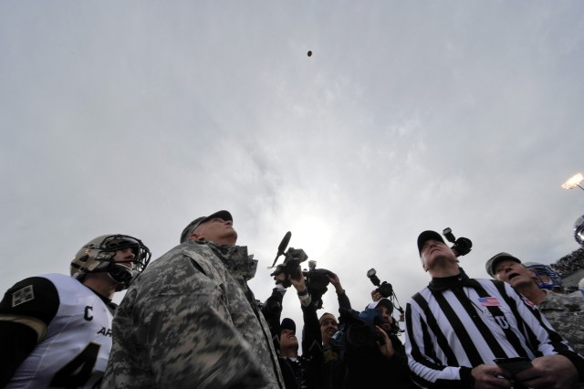 U.S. Army Chief of Staff Gen. Raymond T. Odierno participates in the coin toss prior to the start of the Army Black Knights versus the Air Force Falcons game at the U.S. Air Force Academy in Colorado Springs, CO, Nov. 5, 2011.