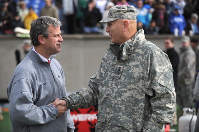 U.S. Army Chief of Staff Gen. Raymond T. Odierno shakes hands with Army Athletic Director Boo Corrigan minutes before the game between the Army Black Knights and the Air Force Falcons at the U.S. Air Force Academy in Colorado Springs, CO, Nov. 5, 2011.