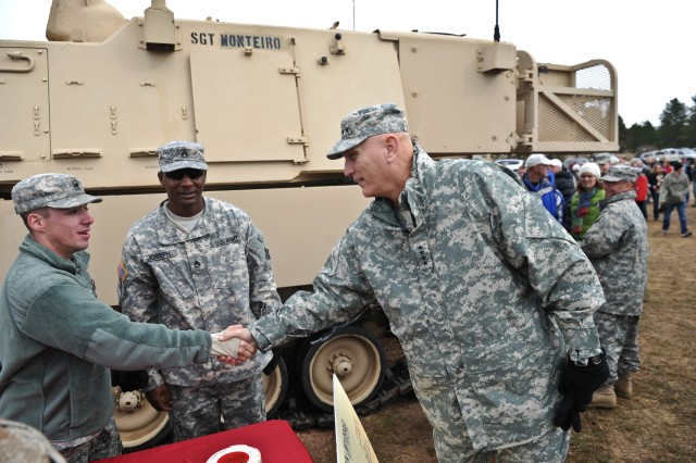 U.S. Army Chief of Staff Gen. Raymond T. Odierno shakes Soldiers hands at the Army tailgate party prior to the game between the Army Black Knights and the Air Force Falcons at the U.S. Air Force Academy in Colorado Springs, CO,  Nov. 5, 2011.