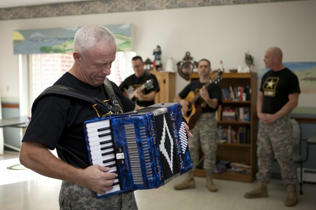 Sgt. Maj. Kirk Kadish, along with The Volunteers of The United States Army Field Band, entertains the residents and staff of Webster Manor Healthcare Center in Massachusetts, Nov. 4.