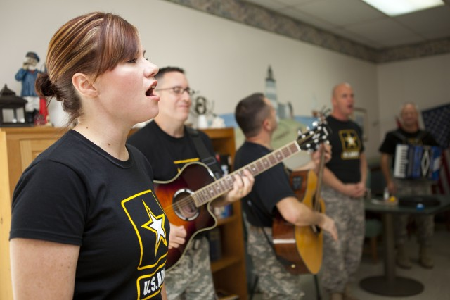 Sgt. 1st Class April Boucher, along with The Volunteers of The United States Army Field Band, entertains the residents and staff of Webster Manor Healthcare Center in Massachusetts, Nov. 4.