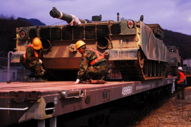 Soldiers from the Republic of Korea's Army conduct rail operations as part of an exercise at Camp Casey, Nov. 6. For the first time ever, ROKA forces used U.S. rail cars to transport their equipment during the exercise.