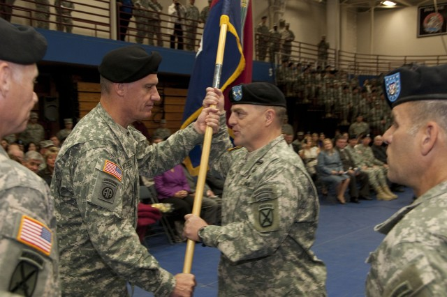Gen. David Rodriguez, U.S. Forces Command commanding general, passes the 10th Mountain Division (LI) colors to Maj. Mark A. Milley, incoming division commander, during a change of command ceremony Friday at Fort Drum's Magrath Gym. Milley assumed command from Maj. Gen. James L. Terry, who's next assignment will be commanding V Corps.