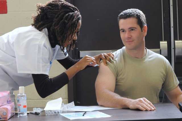 Cpt. Shane Snelling, right, a Military Intelligence officer with Detachment 4, 2100 Military Intelligence Group, receives a flu shot during the Soldier Readiness Processing (SRP) hosted by the 3200 Strategic Intelligence Group, Military Intelligence Readiness Command, US Army Reserve, at Joint Base Anacostia-Bolling, Md., Nov. 5, 2011. Throughout the day Soldiers moved through multiple stations, including dental, immunizations, and vision screening.