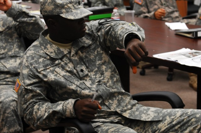 FORT HOOD, Texas - Soldiers from Sgt. 1st Class Richard Suel's driver's training course mimic how it would feel to operate a forklift after graduating Suel's driver's training course, here, October 25.