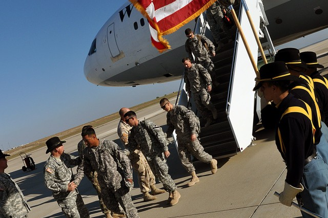 FORT HOOD, Texas--The Soldiers with the 3rd Battalion, 8th Cavalry Regiment, 1st Cavalry Division de-boarded the plane after returning from almost a year in Iraq, Nov. 2. The Warhorse Soldiers were reunited with their family members and loved ones after a their redeployment ceremony held at Cooper Field.