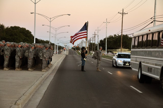 FORT HOOD, Texas--Soldiers with the 3rd Battalion, 8th Cavalry Regiment, 1st Cavalry Division formed up behind the busses before the redeployment ceremony commenced on Cooper Field, Nov. 2. The Warhorse Soldiers' family members waiting anxiously as the unit marched onto the field.