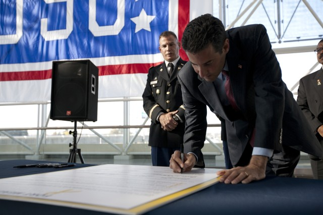U.S. Congressman John Sarbanes signs the Fort Meade Community Covenant during the USO-Metro's Veterans Day ceremony and Fort Meade Community Covenant signing ceremony at BWI International Airport on Tuesday.