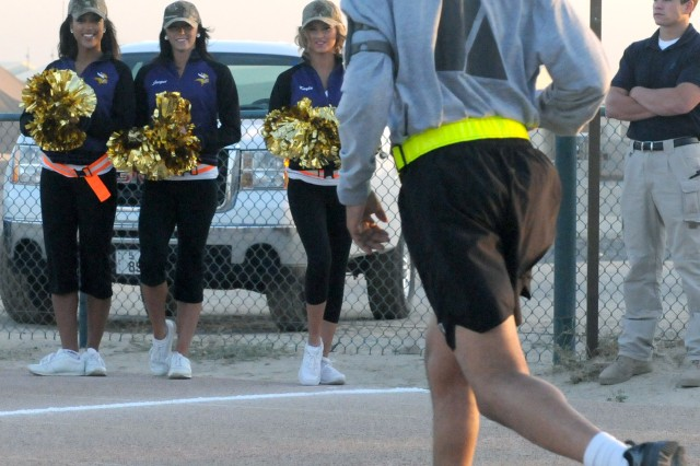 CAMP ARIFJAN, Kuwait - Minnesota Vikings' cheerleaders watch and cheer on  runners as they cross the finish line during Third Army's 93rd Birthday 5K run/walk here Nov. 7. Third Army's commitment to the well-being of its Servicemembers and civilians remains a priority. Through events like the 5K run/walk, Third Army is honoring its 93 years of achievements while keeping troops physically fit to sustain the fight and shape the future.
