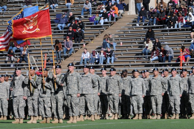 Service members of the 1-17th Field Artillery Regiment participate in the half-time show during the Midwestern State University's military appreciation tribute at Memorial Stadium, Wichita Falls, Texas, Nov. 5, 2011.