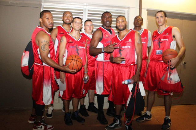 Soldiers with the red team pose for a photo before meeting their professional NBA teammates. The red team faced off against the white team in an intense match-up.