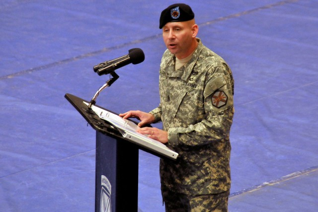 Command Sgt. Maj. John H. Oldroyd, incoming garrison senior enlisted leader, addresses the audience during a change of responsibility ceremony Nov. 8 at Fort Drum's Magrath Gym.