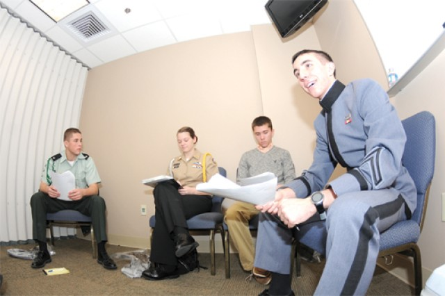 West Point Cadet Kyle O'Grady discusses ethics issues with area high school students Nov. 7 at the Liberty Chapel. O'Grady was one of 10 cadets who volunteered to teach about topics such as honesty and integrity.